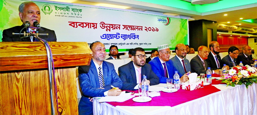 Professor Md. Nazmul Hassan, Chairman of Islami Bank Bangladesh Limited, addressing at a Business Development Conference for Agent Banking at a hotel in the city on Wednesday. Md. Shamsuzzaman, AMD, Mohammad Ali, Abu Reza Md. Yeahia, Hasne Alam, DMDs, Taher Ahmed, Md. Obaidul Haque, SEVPs, Md. Mahboob Alam, Head of Agent Banking Division and other senior officials of the Bank were also present.