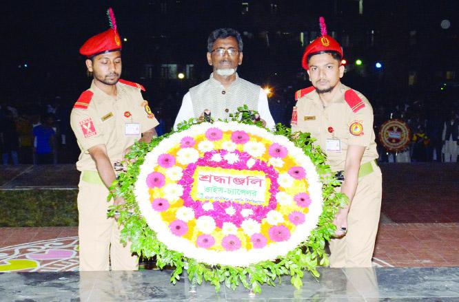 KHULNA: KUET VC Prof Dr Kazi Sazzad Hossain placing wreaths at KUET Shaheed Minar marking the Amar Ekushey and International Mother Language Day on Thursday .
