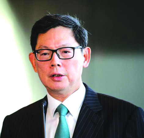 Hong Kong's monetary chief to step down after decade