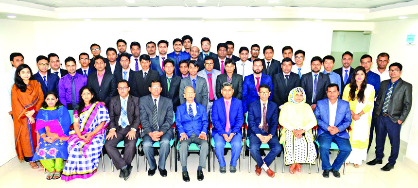 Alauddin A Majid, Chairman, Board of Directors of BASIC Bank Limited, poses for a photograph with the participants of an orientation program on joining of newly recruited Assistant Managers at the Bank's training institute in the city on Wednesday. Senior officials of the Bank were also present.