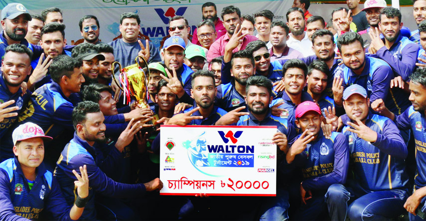 Members of Bangladesh Police Baseball team, the champions of the Walton 6th National Men's Baseball Competition with the guests and officials of Bangladesh Baseball-Softball Association pose for a photo session at the Paltan Maidan on Friday.