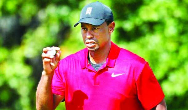 Woods lands birdie, laughs at famed 17 after quadruple-bogey