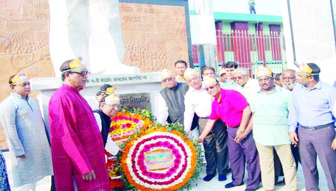 KHULNA: Md Abdus Samad, Secretary of Shipping Ministry placing wreaths on the mural of Bangabandhu Sheikh Mujibur Rahman  marking the birthday of Bangabandhu and the National Children's Day at  Bangladesh Betar Khulna on Sunday.