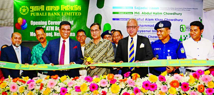 Sajjadul Hasan, Secretary of Prime Minister's Office, inaugurating a new ATM Booth of Pubali Bank Limited, at Mohongonj in Netrakona as chief guest recently.Md. Abdul Halim Chowdhury, Managing Director, Safiul Alam Khan Chowdhury, AMD and Mohammad Ali, DMD of the bank were also present.