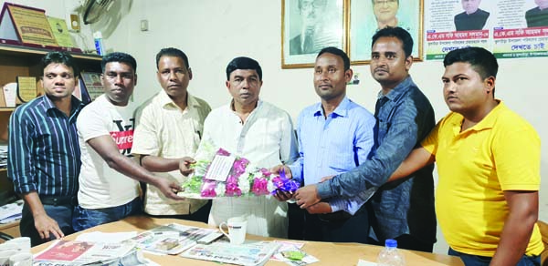 KULAURA (Moulvibazar): Joint Secretary of  Upazila Awami League and Editor of Weekly Kulaurar Dak  Principal A K M Shafi Ahmed Solman  being greeted by the journalists and employees of Kulaurar Dak  as he has been elected upazila chairman yesterday .
