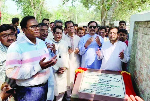 NILPHAMARI: Asaduzzaman Noor MP offering Munajat after inaugurating the construction work of six kilometers LGED road in Nilphamari on Saturday noon.