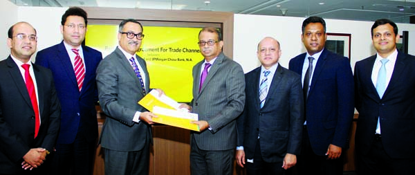 Ali Reza Iftekhar, Managing Director of Eastern Bank Limited (EBL) and  Madhav Kalyan, Managing Director of J P Morgan Chase Bank NA, India and head of corporate banking (South and Southeast Asia), exchanging a partnership agreement signing documents for processing letter of credit documents through electronic channel at EBL head office in the city recently. Top officials from both the organizations were also present.
