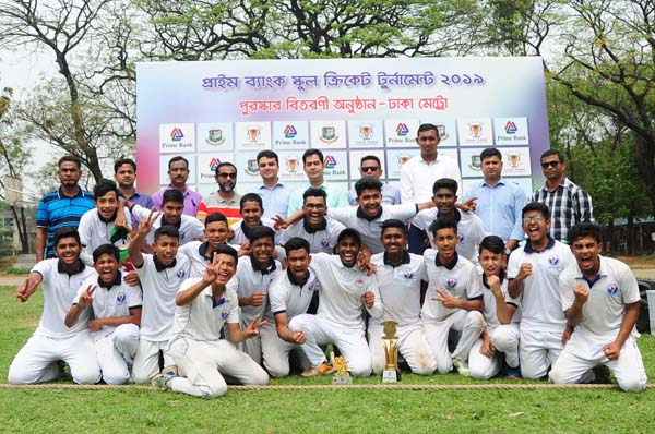 Members of Willes Little Flower School, the champions of the Prime Bank National School Cricket (Dhaka Metropolis) Tournament with the guests and officials of Bangladesh Cricket Board and Prime Bank Limited pose for photograph at the Shaheed Sergeant Zahurul Haque Hall Playground of Dhaka University on Tuesday.