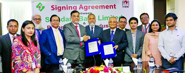 Md. Motaleb Hossain, DMD of Standard Bank Limited and M A Awal, Chairman of Prime Group of Industries, exchanging an agreement signing document at the Bank's head office in the city on recently. Under the deal, around five thousand employees of the group will get their salaries through the benefit-rich savings account of the Bank. Mamun-Ur-Rashid, Managing Director, Md. Tariqul Azam, AMD of the Bank, Asif Mahmud and Sanjida Awal, Directors of the group were also present.
