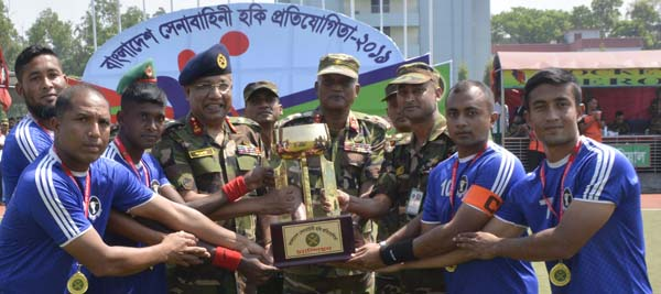 Area Commander of Savar Area and General Officer Commanding of 9 Infantry Division Major General Mohammad     Akbar Hossain handing over the trophy to the members of 33 Infantry Division Hockey team, which emerged as the champions of Bangladesh Army Hockey Competition at the Hockey Turf in Bangladesh Krira Shikkha Protishtan (BKSP), Savar on Thursday. High officials of Bangladesh Army were present at the time.
