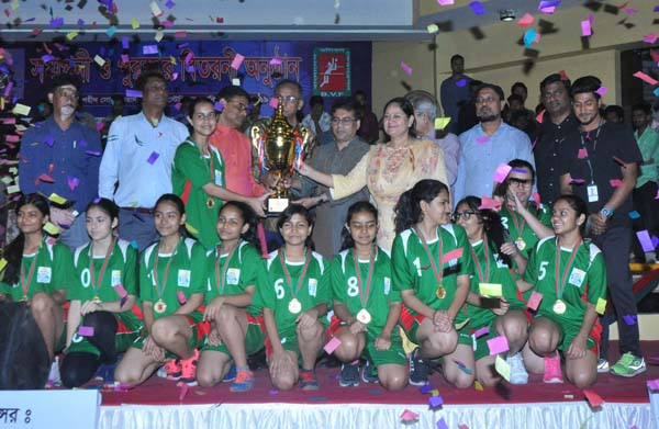 Scholastica, the champions of the Girls' Division of the Panam Group Dhaka Metropolis School Volleyball Competition with the guests and officials of Bangladesh Volleyball Federation pose for a photo session at the Shaheed Suhrawardy Indoor Stadium in the city's Mirpur on Thursday.