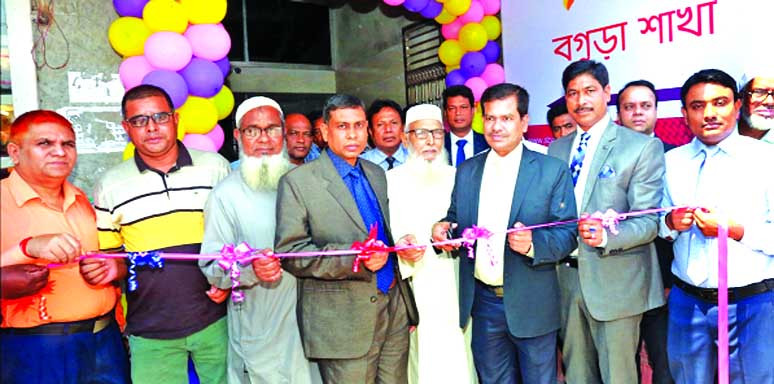 Md. Bayazid Sk, Head of Banking Operations Division of South Bangla Agriculture & Commerce (SBAC) Bank Limited, inaugurating its shifted Bogura Branch to new location at Talukdar Plaza of Barogola in Rangpur Road in Jhautala in Razabazar on Tuesday. Md. Delwar Hossain Mondol, Branch Manager of the Bank and local elites were also present.