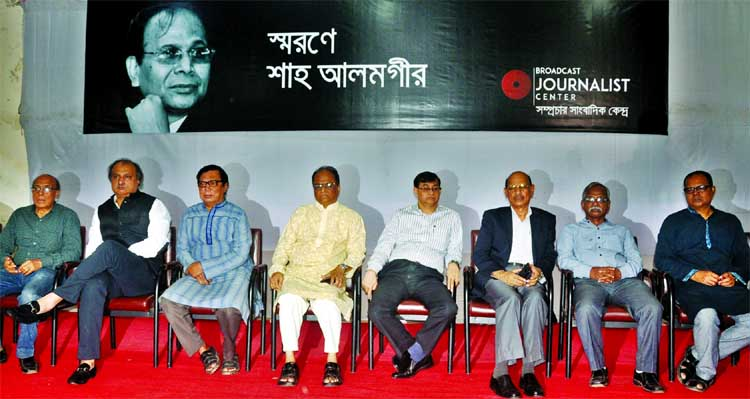 Jatiya Press Club President Saiful Alam along with other senior journalists at a memorial meeting on former DG of PIB journalist Shah Alamgir organised by 'Samprochar Sangbadik Kendra' at the club on Friday.