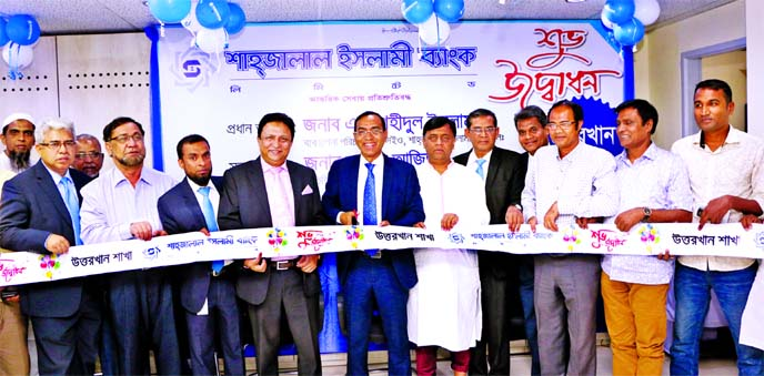 M. Shahidul Islam, Managing Director of Shahjalal Islami Bank Ltd, inaugurating its 123rd branch at Uttarkhan, Uttara in Dhaka on Sunday. Additional Managing Director of the Bank Md Abdul Aziz presided.