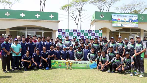 Players of Chattogram Knights (Chattogram Zone) and Dhaka Warriors (Dhaka Zone) pose with the chief guest Sayed Waseque Md Ali, Managing Director of First Security Islami Bank Ltd (FSIBL) and the other FSIBL high officials, Abdul Aziz, Additional Managing Director, Md Mustafa Khair, Deputy Managing Director, Md Hafizur Rahman, Chattogram Zonal Head, SM Nazrul Islam, Head of General Services Division of Head Office, at BKSP in Savar on Saturday. A friendly cricket match between First Security Islami Bank Ltd (FSIBL) Dhaka Zone and Chattogram Zone held at the same venue on the same day. Chattogram Zone (Chattogram Knights) defeated Dhaka Zone (Dhaka Warriors) by 8 wickets.
