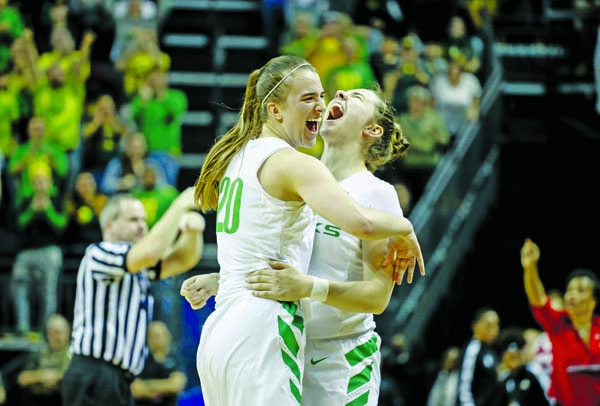 Oregon guard Sabrina Ionescu (20) celebrates with guard Morgan Yaeger (2) in the closing moments against Indiana during a second-round game of the NCAA Women's College Basketball Tournament in Eugene on Sunday, Ore. Oregon won 91-68.