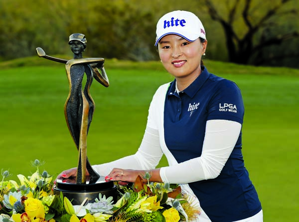 Jin Young Ko poses with the trophy after winning the Founders Cup LPGA golf tournament in Phoenix on Sunday.
