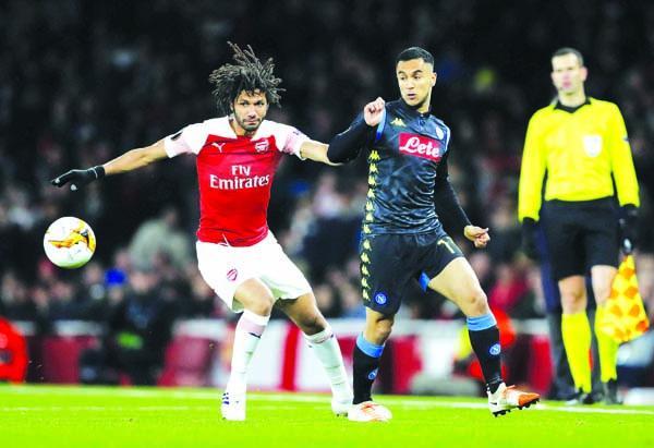 Ramsey sparkles as Arsenal sink Napoli