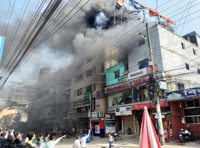 A devastating fire gutted shops at Zilani Market at Cox's Bazar yesterday.