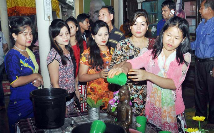 Buddhist girls at Nobo Pandit Bihar in Katalganj performing rituals  to welcome the Pahela Baishakh on Friday.