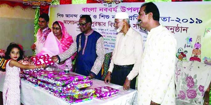 JHENAIDAH: Md Abdul Hai MP distributing prizes among the winners of cultural competition on the occasion of the Pahela Baishakh organised by Jhenaidah Shishu Academy  on Sunday.