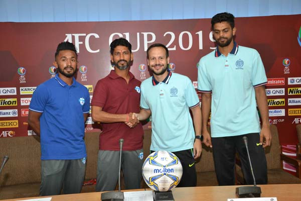 Head Coach of Dhaka Abahani Limited Mario Lemos (second from right) and Head Coach of Minerva Punjab of India Sachin Badadhe (second from left) shaking hands at the conference room of Bangladesh Football Federation House on Tuesday.