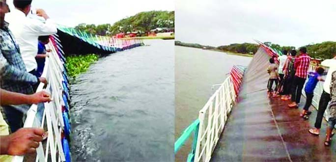 BENAPOLE: The first floating bridge Jhampa Baor in Manirampur Upazila  has  been broken by nor'wester on Saturday night.
