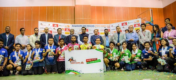 The winners of the Table Tennis Competition of the Bangabandhu Inter-University Sports Champs 2019 with Chief Guest Nasrul Hamid, MP, State Minister for Power, Energy & Mineral Resources, Nahim Razzaq, MP, Convener of the Bangabandhu Inter-University Sports Champs, Dr Kazi Anis Ahmed, Joint-Secretary of Association of Private Universities of Bangladesh (APUB), Hedayetullah Al Mamun, President of Bangladesh Table Tennis Federation, Md Shafiul Azam, Managing Director & CEO of Modhumoti Bank Limited, Professor Dr Atiqul Islam, Vice-Chancellor of North South University, Md Alamgir Hossain Khan, General Manager & Head of Finance of Polar Ice Cream and other distinguished guests pose for a photo session at North South University in the city on Tuesday.