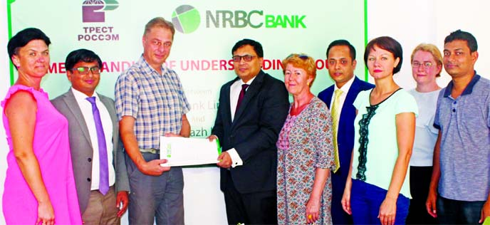 Hafiz Imroz Mahmud, Head of Retail Banking Division of NRBC Bank Limited and Georgiy Perezhogin, Director of PRB Branch of Trest Rosspetsenergomontazh Limited Trade Corporation, Russia, the general contractor of Rooppur Nuclear Power Plant Project exchanging a MoU signing document to provide all kinds of banking services to the project at the bank's Rooppur branch on Tuesday. Senior executives from respective organizations were also present.