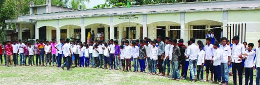 JOYPURHAT: Students of  Hinda High School in Khetlal Upazila  boycotting  classes protesting several irregularities of the school on Thursday.
