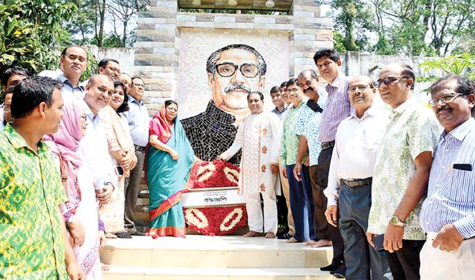 Prof Dr Iftekhar Uddin Chowdhury, VC and Prof Dr Shirin Akter , Pro-VC Chittagong University placing wreaths at the portrait of Father of the Nation Bangabandhu Sheikh Mujibur Rahman on the campus observing the historic Mujibnagar Day on Wednesday.