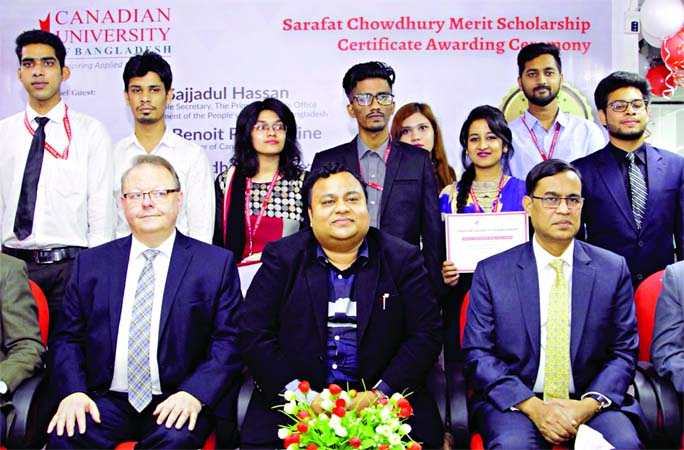 Secretary to the Prime Minister's Office Sajjadul Hassan, High Commissioner of Canada in Bangladesh Benoit Préfontaine, Chairman of Board of Trustees of CUB Professor Dr Chowdhury Nafeez Sarafat and scholarship awardees pose for a photo after Sarafat Chowdhury Merit Scholarship award ceremony at Canadian University of Bangladesh (CUB) on Saturday.