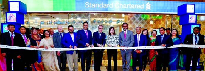 Robert Chatterton Dickson, British High Commissioner to Bangladesh along with Judy Hsu, Regional CEO (ASEAN & South Asia) of Standard Chartered Bank, inaugurating its new branch at city's Gulshan- 2 area recently. Senior officials from Standard Chartered Bangladesh, including Eva Ang, Regional Head, Corporate Affairs and Brand & Marketing, ASEAN & South Asia, Sabbir Ahmed, Head of Retail Banking, Enamul Huque, Head of Global Banking and Bitopi Das Chowdhury, Head of Corporate Affairs, Brand & Marketing of the Bank were also present.