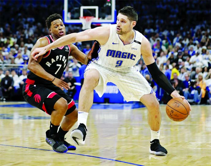 Orlando Magic's Nikola Vucevic (9) moves the ball against Toronto Raptors' Kyle Lowry (7) during the second half in Game 3 of a first-round NBA basketball playoff series in Orlando, Fla on Friday.