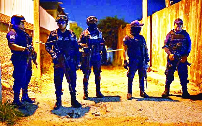 Police officers guard a crime scene where unidentified assailants opened fire at a bar in Minatitlan in Veracruz state of Mexico.