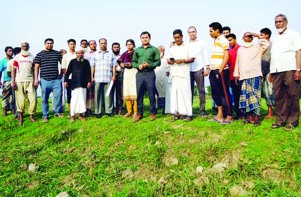 SYLHET: Mintu Chowdhury, UNO, South Surma Upazila visiting construction work of Sheikh Russel Mini Stadium at Silam Union recently.