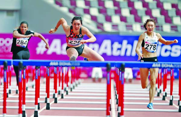 Meg Hemphill of Japan (center), Nadiah Alhaqqah of Kuwait (left) and Jeong Yeonjin of South Korea compete during Heat 1 for 100m hurdles race of the decathlon at the Asian Athletics Championships in Doha, Qatar on Monday.