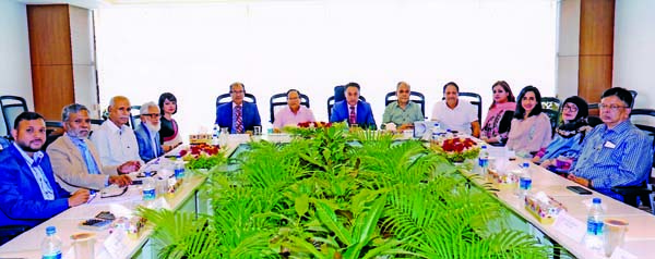 Abdullah Al-Mahmud (Mahin), Chairman of Crystal Insurance Company Limited, presiding over its 83rd meeting at its head office in the city on Sunday. AHM Mozammel Hoque, Md. Tajul Islam,  Farhana Danesh, Shahzadi Begum, Soera Zahir, Nusrat Mahmud, Directors and Mia Fazle Karim, CEO of the company were also present.
