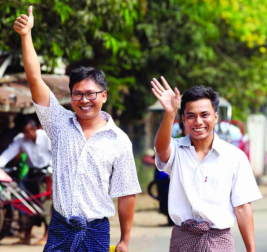 Image result for 2 Reuters Reporters Walk Free After Spending 500 Days In Myanmar Jail