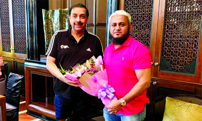 General Secretary of Bangladesh Hockey Federation AKM Mominul Haque Sayeed (right) giving a bouquet to Taiyeb Ikram, Chief Executive Officer of Asian Hockey Federation (AHF), at the Head Office of AHF in Kuala Lumpur, the capital city of Malaysia on Thursday.