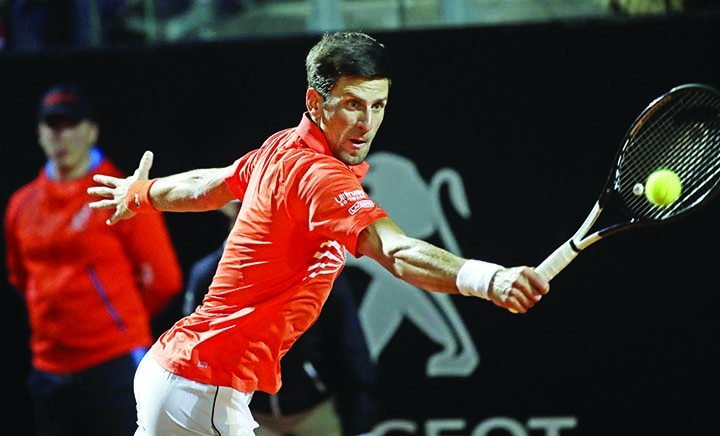 Djokovic survives scare, Nadal coasts into Rome semi-finals