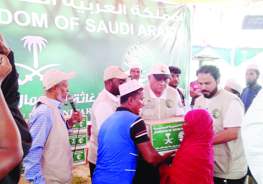 LAKSHAM (Cumilla ): King Salman Humanatrian Aid and Relief Centre distributing   Iftar items among underprivileged people  through  International Organization for Relief, Welfare and Development (IORWD) on Bakai Ideal School ground at  Laksham Upazila  in Cumilla yesterday.