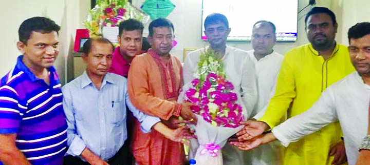 Bangladesh Awami Swechchhasebok League Acting General Secretary Gazi Mesbaul Hossain Shachchu  being greeted by leaders and activists at his Kafrul office as he has taken charge of Acting General Secretary of the organization recently .