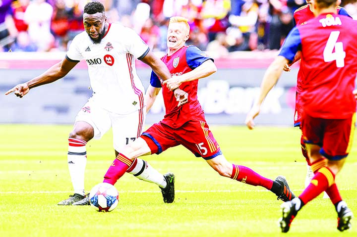 Real Salt Lake defender Justen Glad (15) grabs the wrist of Toronto FC forward Jozy Altidore (17)  during an MLS soccer match in Sandy Utah on Saturday.