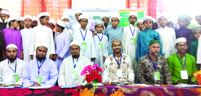 BETAGI (Barguna): Selected participants of Quran recitation  competition posed for a photo session at Darul Ulum Hafizia Qawmi Noorani Madrasa in Bholanathpur premises organiaed by Citizen Voice on Sunday.