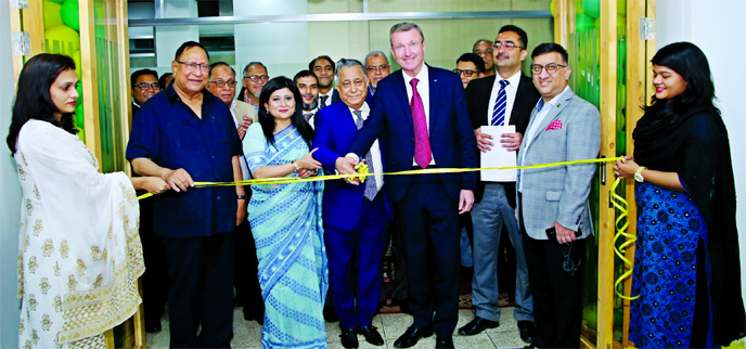 Nasir A. Chowdhury, Advisor and Founding Managing Director of Green Delta Insurance Company (GDIC), inaugurating a new office premises for Professional Advancement Bangladesh Ltd (PABL), a subsidiary of GDIC at Gulshan-1 in the city on Monday. Keith Richards (MD & CEO of Engagement & Personal Finance Society, CII UK) and Farzanah Chowdhury, Chartered Insurer (CEO of GDIC) were also present.