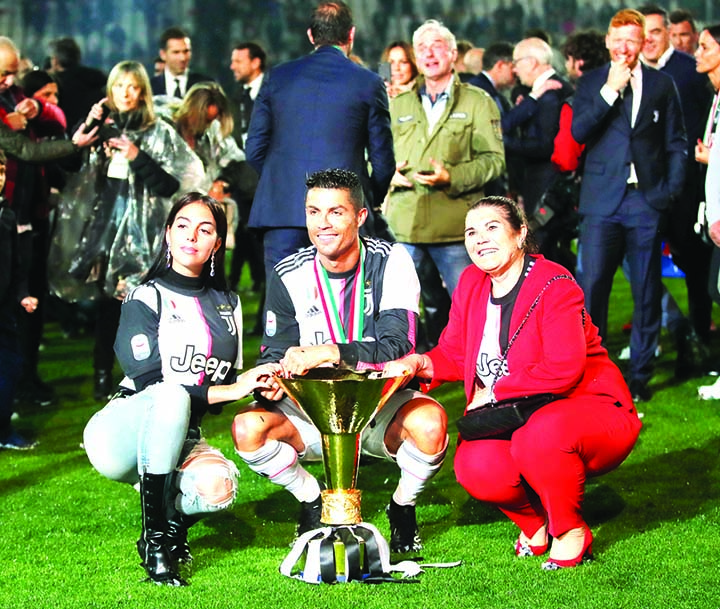 Juventus' Cristiano Ronaldo (center) is flanked by his girlfriend Georgina (left) and his mother Dolores Aveiro (right)      after winning the Serie A soccer title trophy, at the Allianz Stadium, in Turin, Italy on Sunday.