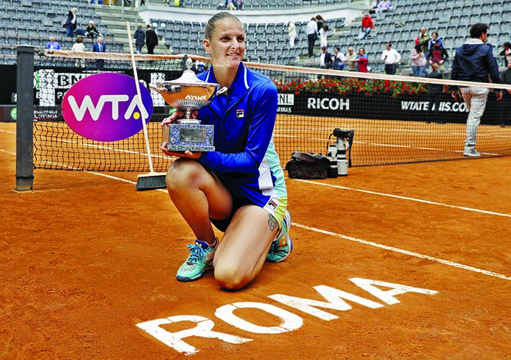 Karolina Pliskova of the Czech Republic holds the trophy after winning the final match against Johanna Konta at the Italian Open tennis tournament in Rome on Sunday. Karolina Pliskova captured the biggest clay-clay-court title of her career by beating Johanna Konta 6-3, 6-4 in the Italian Open final.