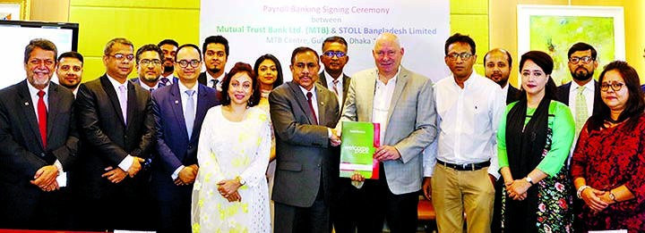 Thomas Hoffmann, Chief Executive Officer of STOLL Bangladesh Ltd and Syed Rafiqul Haq, Deputy Managing Director of Mutual Trust Bank Ltd, exchanging an agreement signing document at the Bank's head office in the city recently. AKM Habibullah, Director of STOLL Bangladesh Ltd, Sultana Shikder Ahona, Head of Payroll Banking, Md. Bakhteyer Hossain, Head of International Trade Services Division and Samia Chowdhury, Deputy Head of Communications Department of MTB, among others, were present. Under this deal, the employees of the company can avail Payroll Banking solutions.