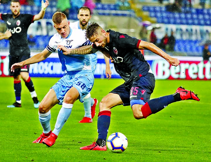 Lazio's Nicolo Armini (left) and Bologna's Mitchell Dijks vie for the ball during an Italian Serie A soccer match between Lazio and Bologna, at the Olympic stadium in Rome on Monday.